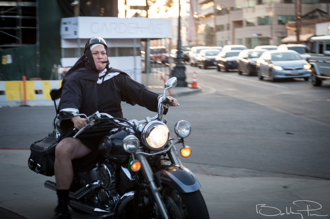 Dot Marie Jones driving her Harley onto the Artemis black carpet at 2018 Artemis Awards Gala 4/26 in Beverly HIlls CA